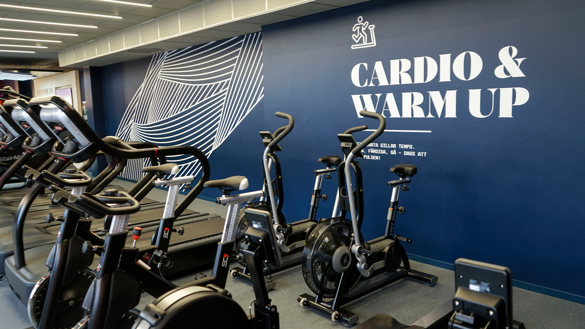 The cardio and warmup area at Fitness24Seven